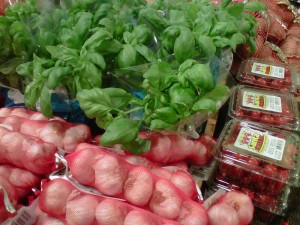 Garlic, tomatoes, basil in grocery store